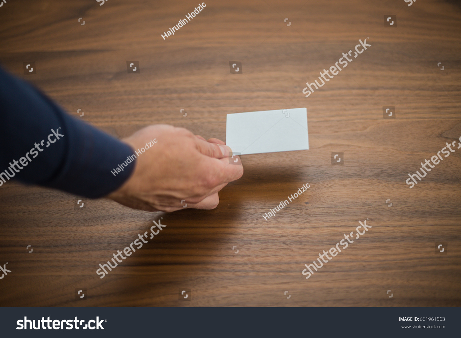 Bank card business card businessman holds stock photo 661961563 bank card business card businessman holds card in hand finances jobs magicingreecefo Choice Image