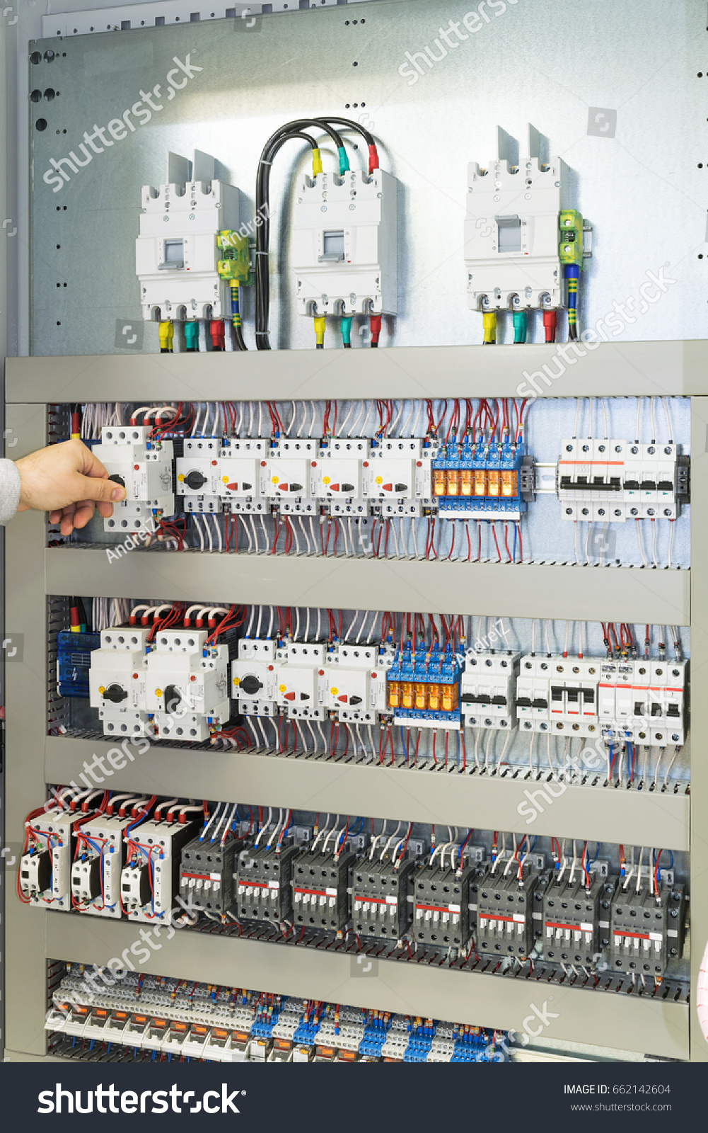 Man Turns Off Circuit Breaker Protecting Stock Photo Edit Now Thermal Breakers Trip And Turn The If Current Motor In An Electric Cabinet Or Panel