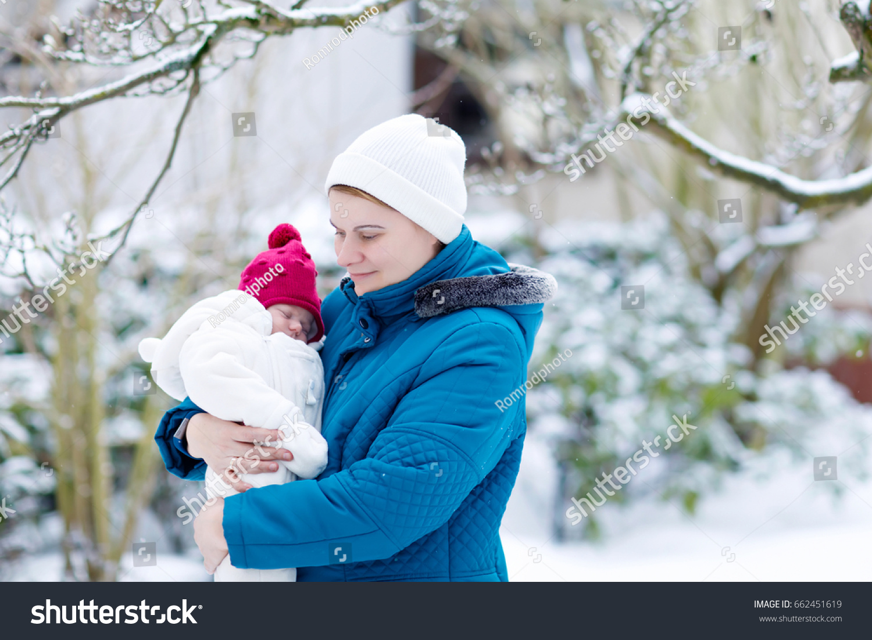 Happy Mother Holding Newborn Baby Girl Stock Image