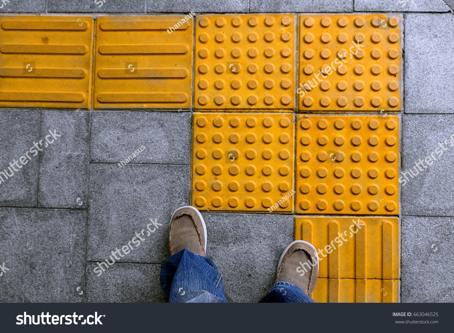 Shoes on block tactile paving blind stock photo 663046525 shoes on block tactile paving for blind handicap on tiles pathway walkway for blindness people dailygadgetfo Image collections