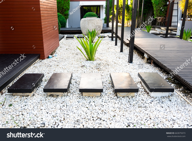 Black Rocks Walking Way In Tropical Garden, Black Stones Garden Path On White  Pebbles And