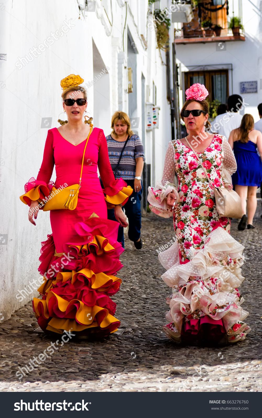 f2246e7823e2 GRANADA, SPAIN - MAY 5, 2017: Women wearing traditional flamenco dresses  during Fiesta de las Cruces in Andalucia, Spain - Image