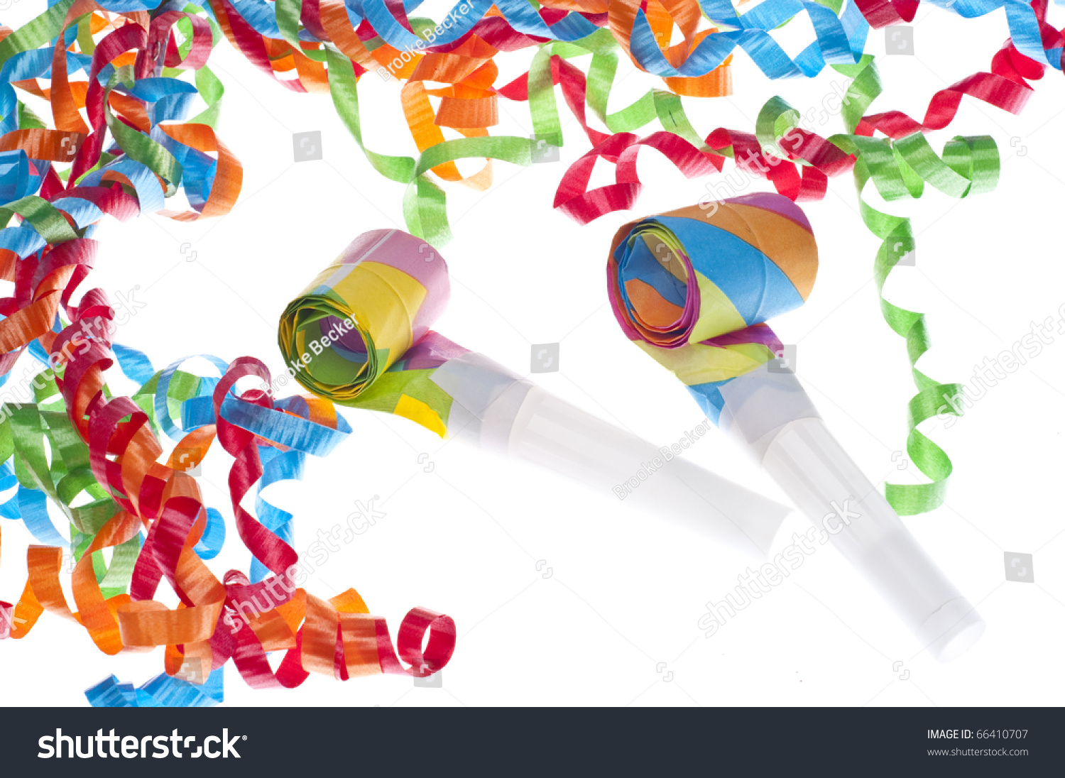 new year party concept with streamers and noise makers on white