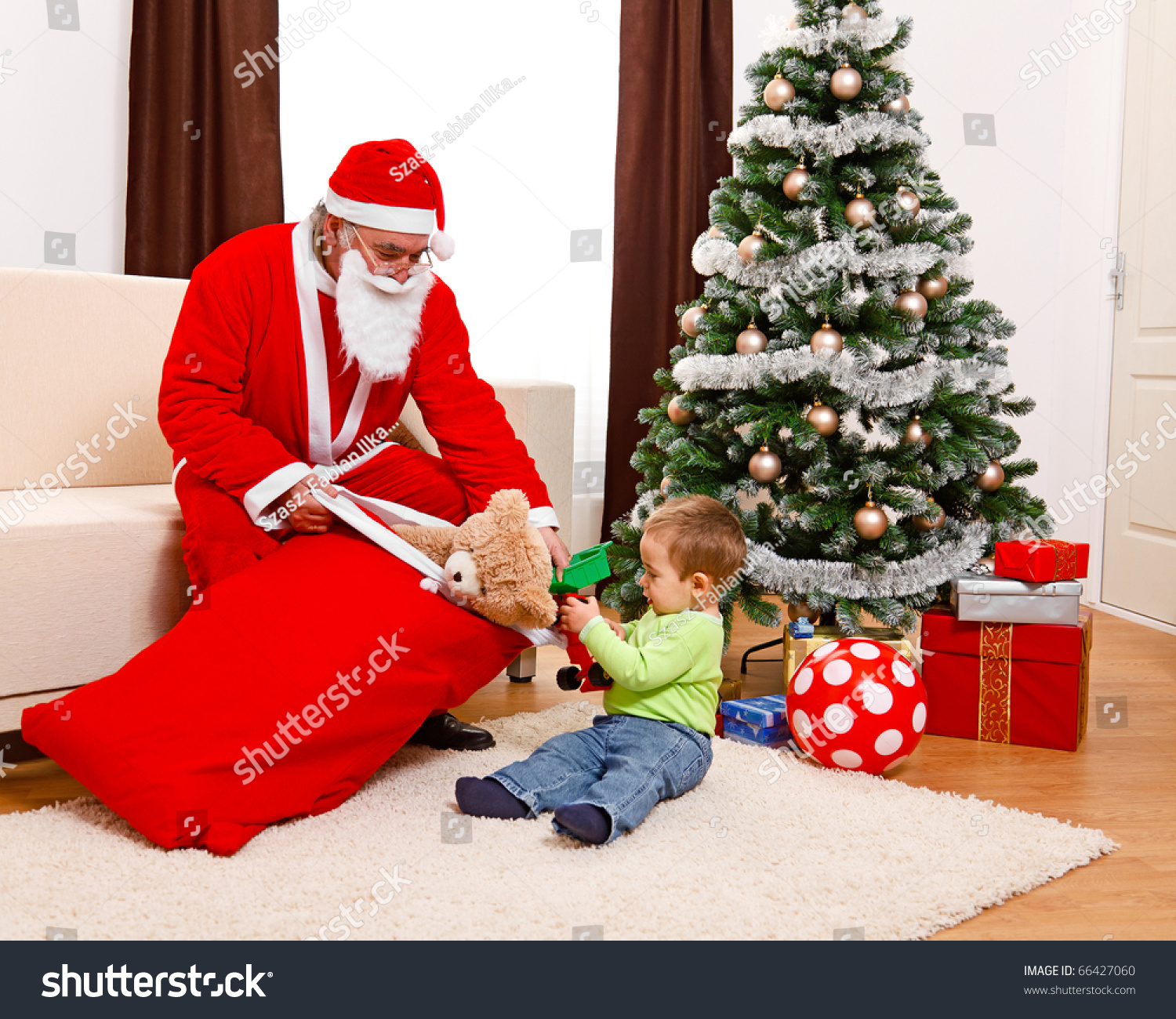 Little Boy Christmas Taking Out Toys Stock