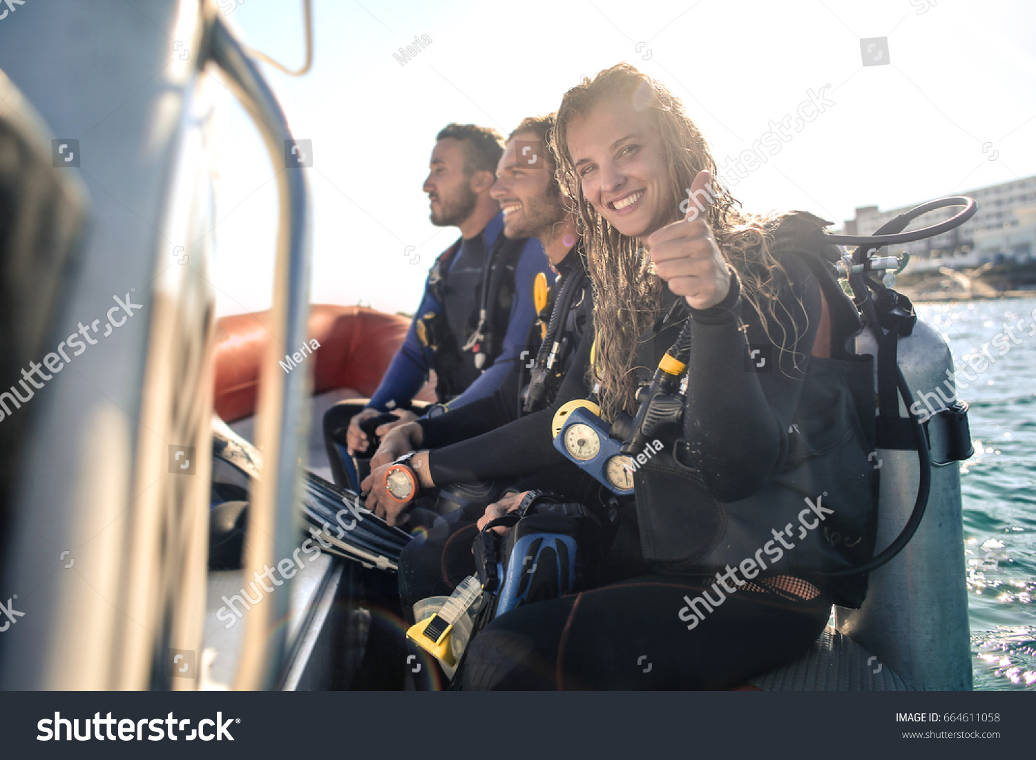 Group of scuba divers on a boat #664611058
