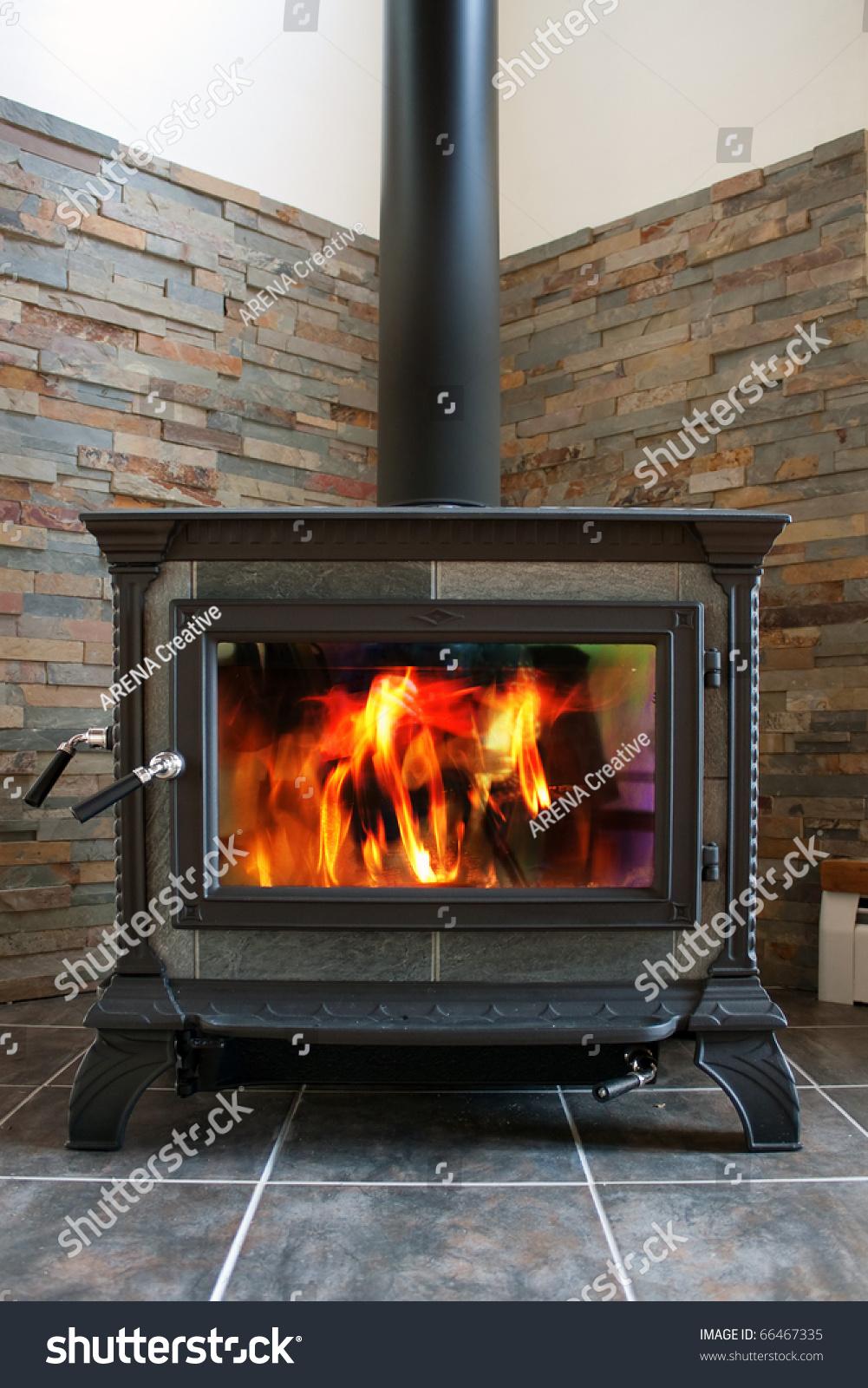 new cast iron wood stove burning stock photo 66467335 shutterstock