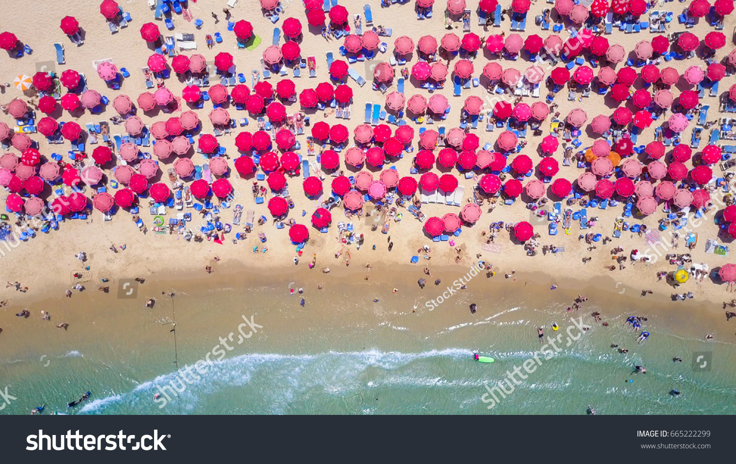 Tropical beach with colorful umbrellas - Top down aerial view #665222299