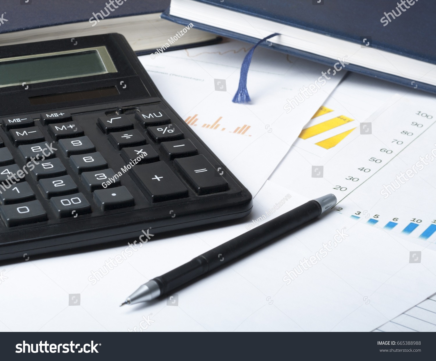 chart accounting books pen calculator on wooden office table home