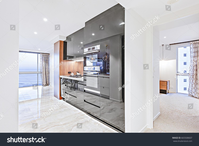 Modern Kitchen Including Black Pantry Cupboards Stock Photo (Royalty ...