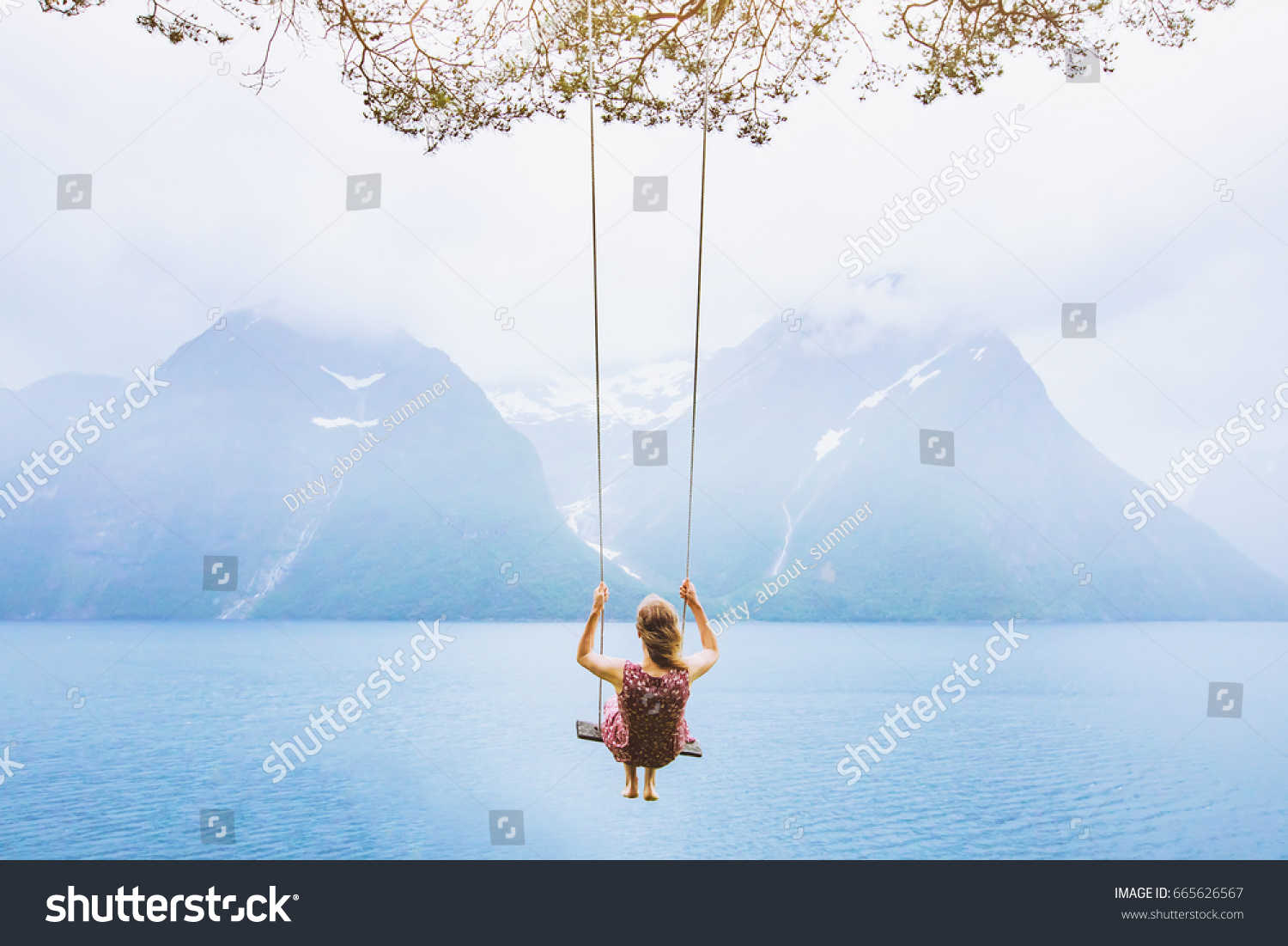 dream concept, beautiful young woman on the swing in fjord Norway, inspiring landscape #665626567