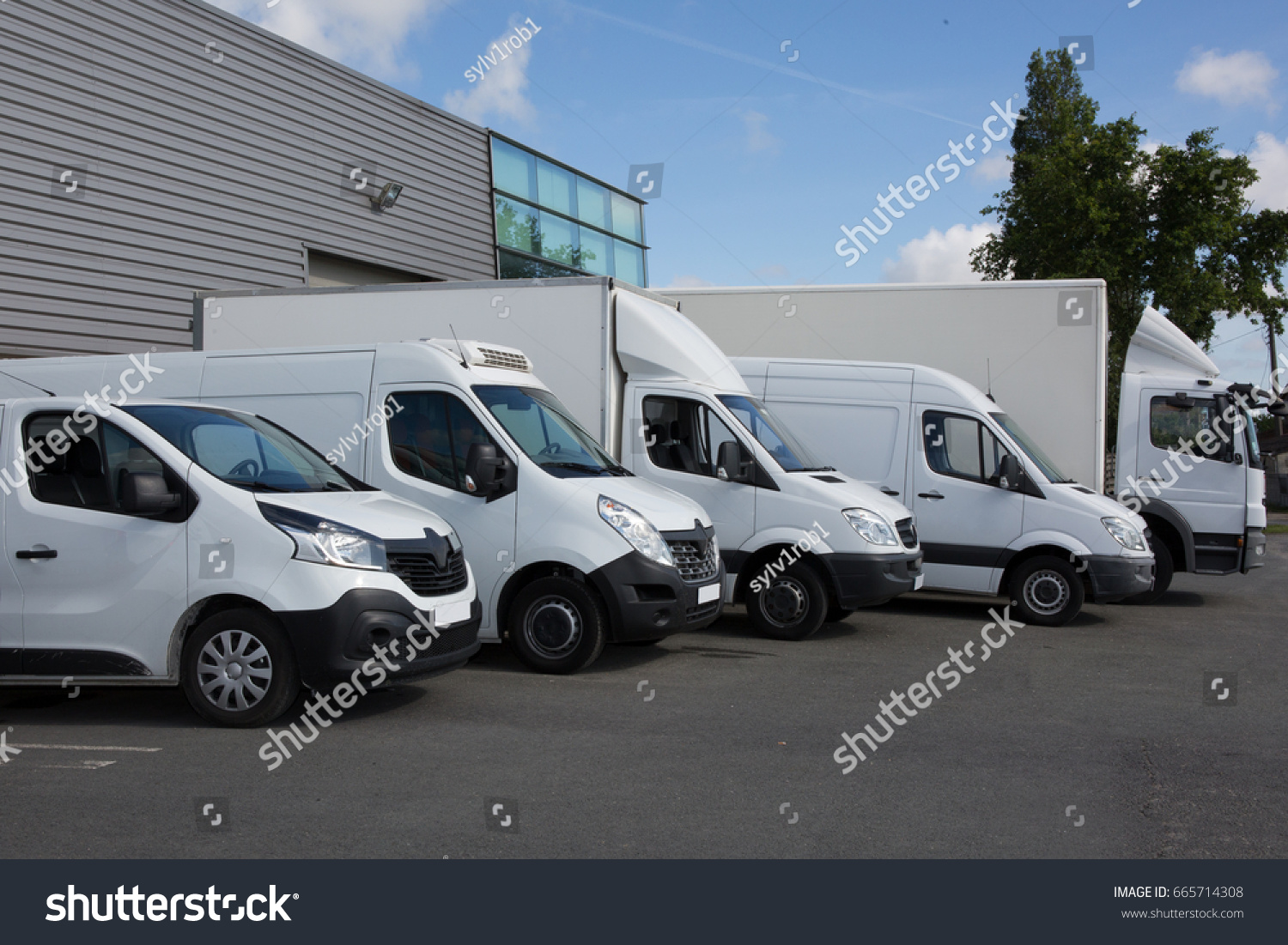 Several cars vans and trucks parked in parking lot for sale #665714308
