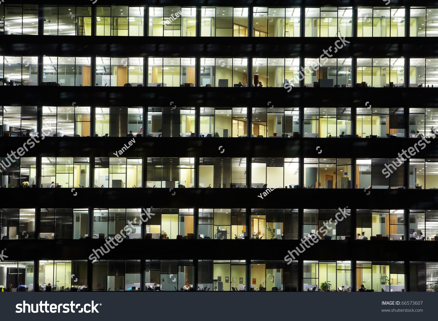 Working In A Tall Office Building At Nigth