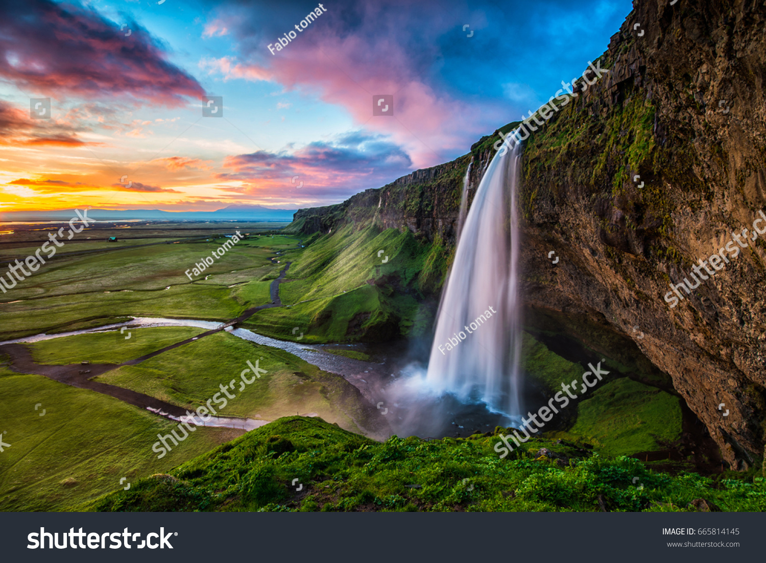 Seljalandsfoss - Seljalandsfoss is located in the South Region in Iceland right by Route 1. One of the interesting things about this waterfall is that visitors can walk behind it into a small cave.   #665814145