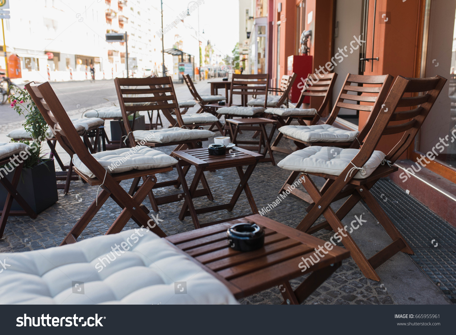 Beautiful outdoor cafe setting. Chairs with cushions and small tables at a coworking space and & Beautiful Outdoor Cafe Setting Chairs Cushions Stock Photo (Download ...