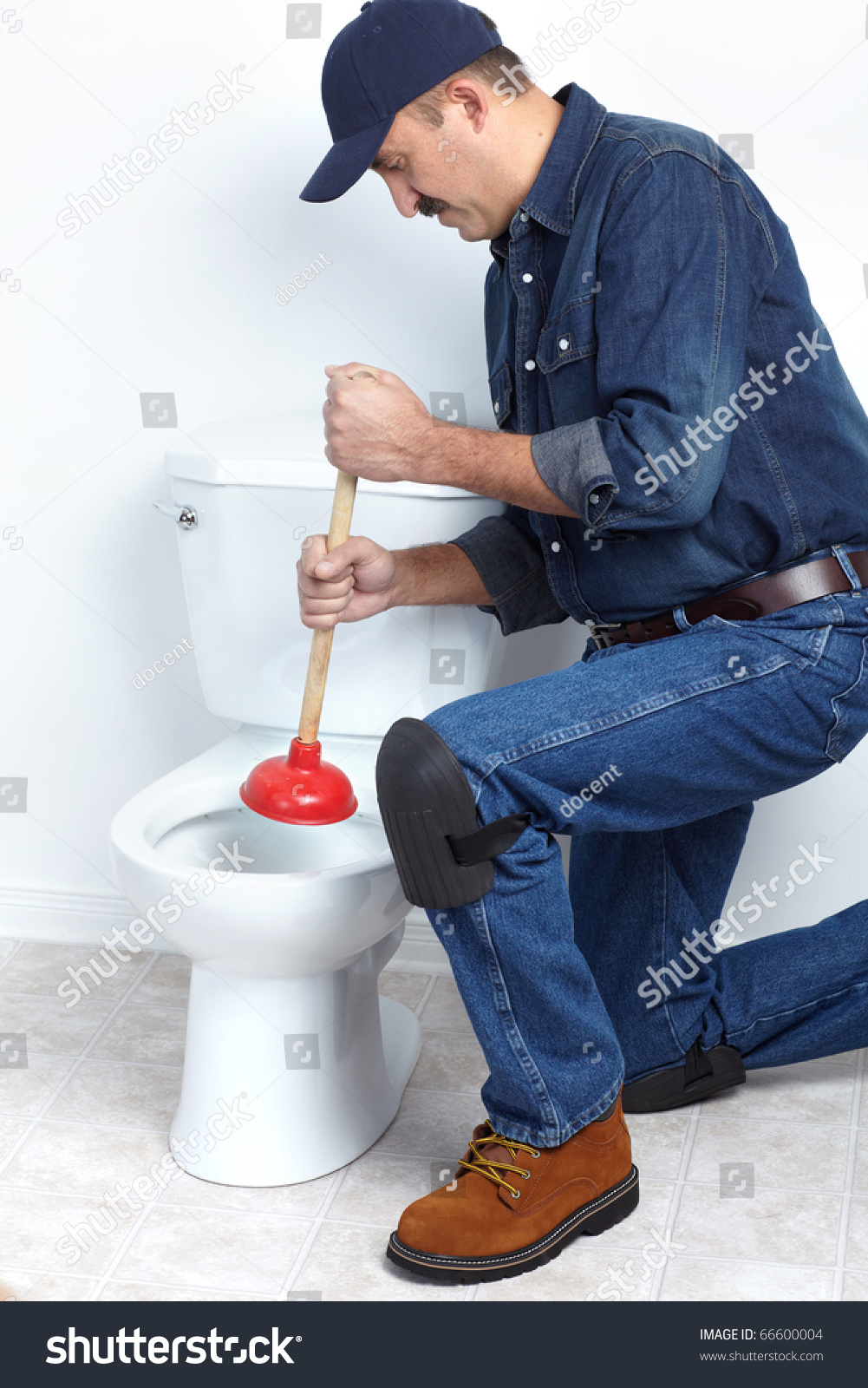 plumber with a toilet plunger stock photo 66600004 shutterstock. Black Bedroom Furniture Sets. Home Design Ideas