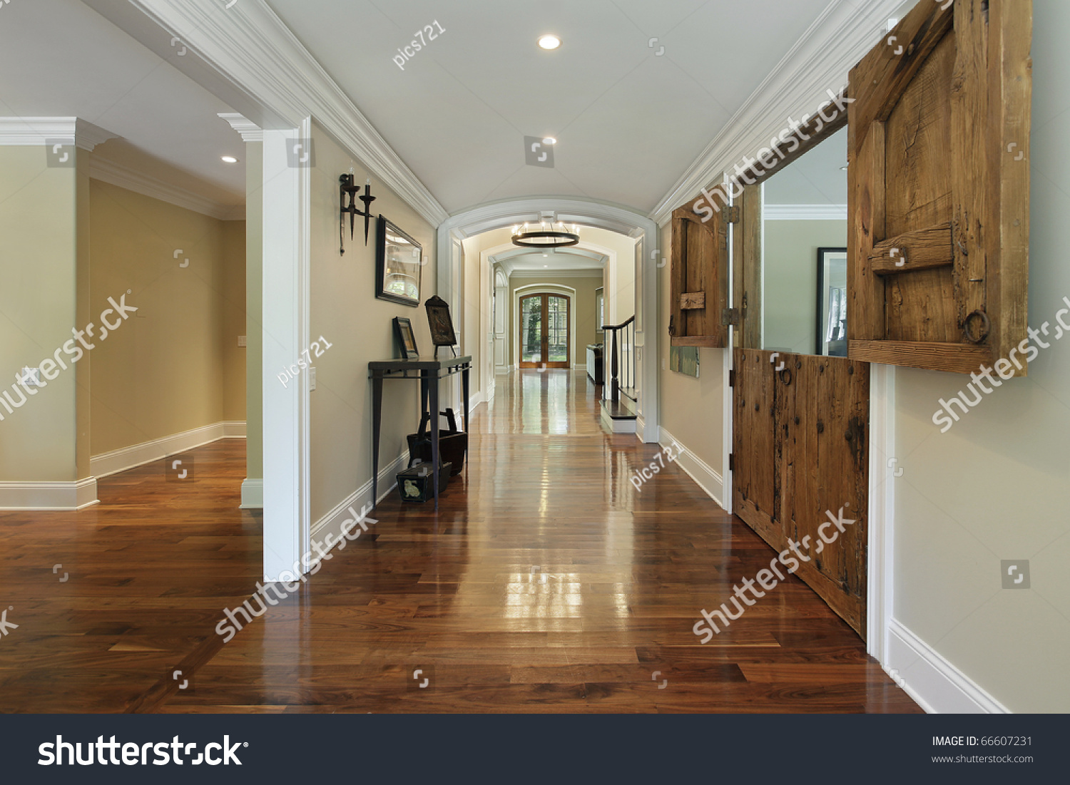 Long Foyer : Long foyer with wooden barn doors into living room stock