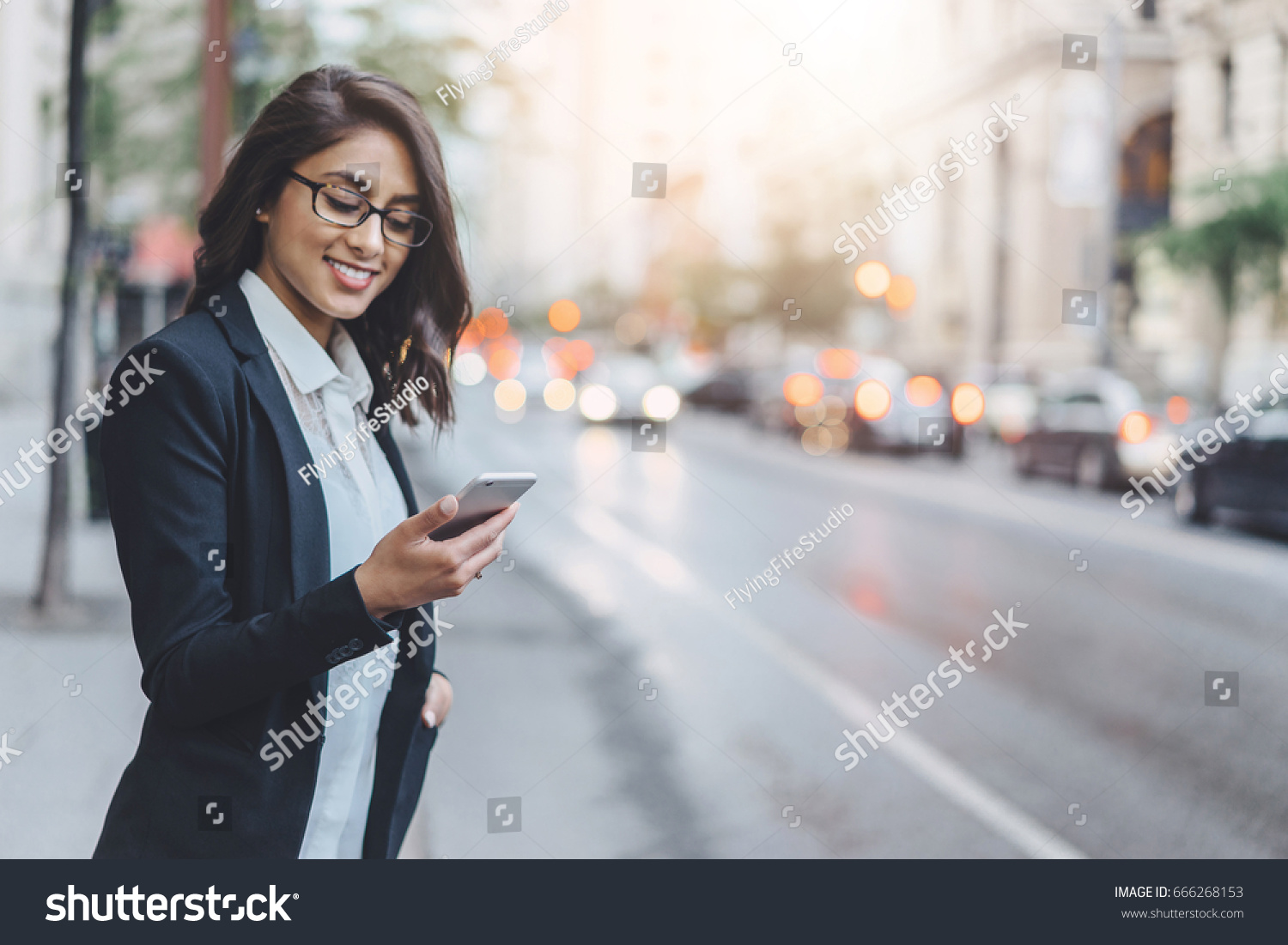 Professional business woman using technology outside to the crossroads #666268153