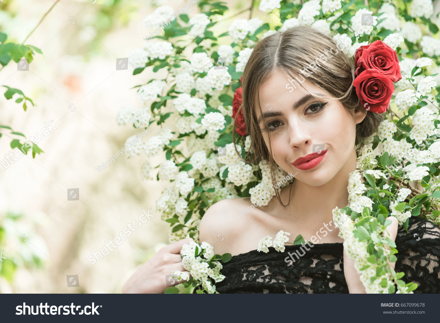 Girl With Fashionable Makeup And Red Lips Has Rose Flower In Hair