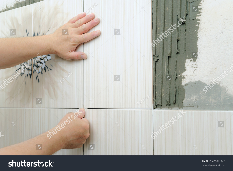 Tilers Hands Installing Ceramic Tile On Stock Photo (Royalty Free ...