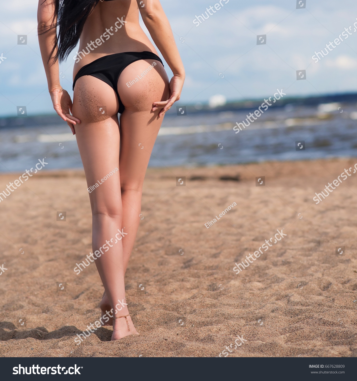 Sexual Woman On The Beach With Sand Ass In Bikini Summer