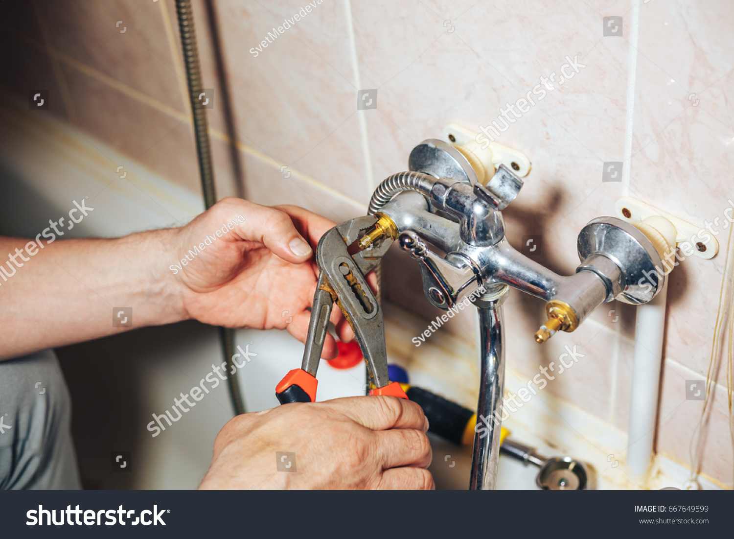 Fixing A Leaky Faucet. Latest Water Leaked Out Of The Spout Nut At ...