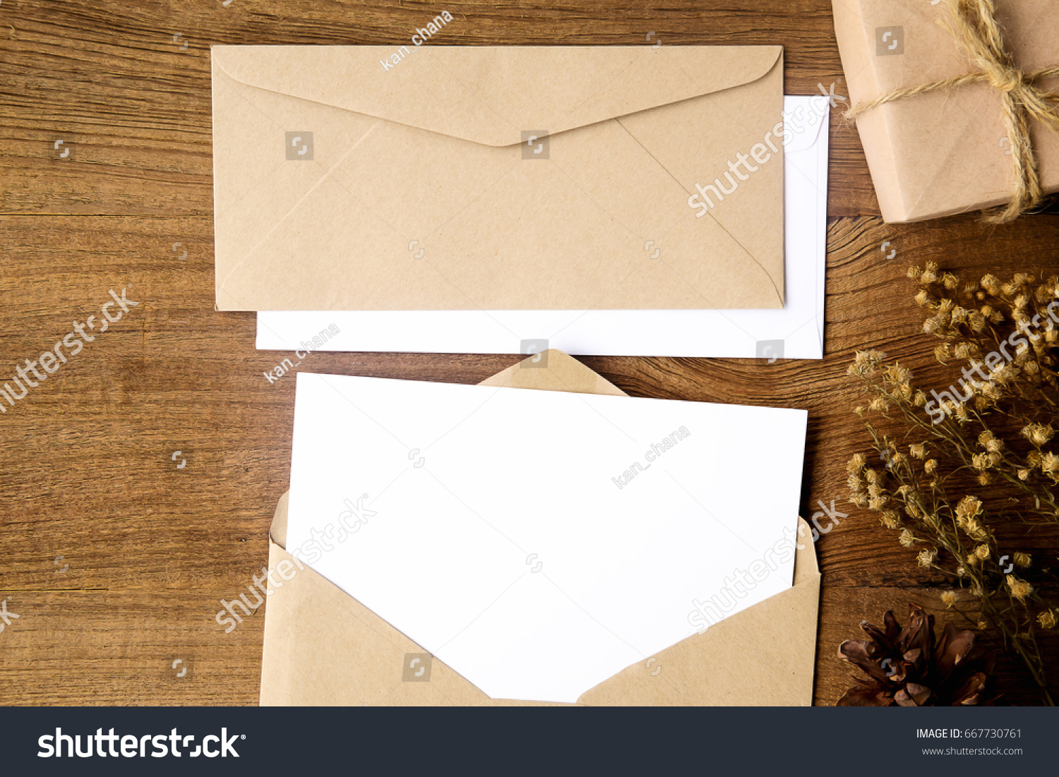 Top View Of Envelope And Blank Greeting Card With Rose Flowers On