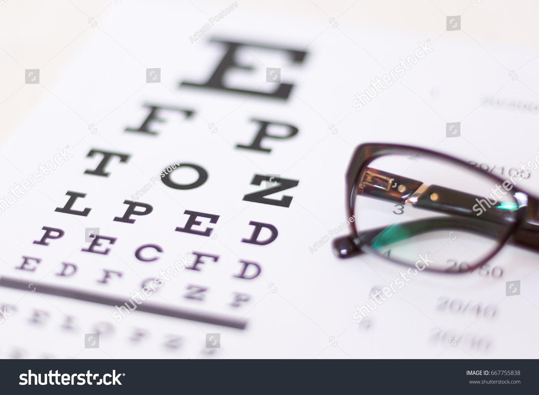 Eye glasses on eyesight test chart stock photo 667755838 eye glasses on eyesight test chart stock photo 667755838 shutterstock nvjuhfo Images