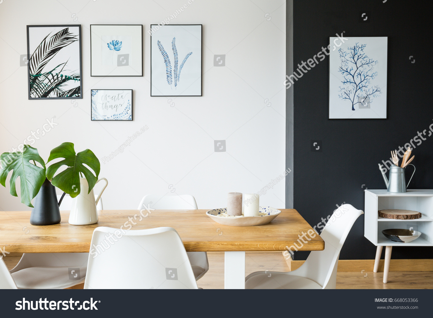 Black and white dining room with wooden table and posters. Black White Dining Room Wooden Table Stock Photo 668053366