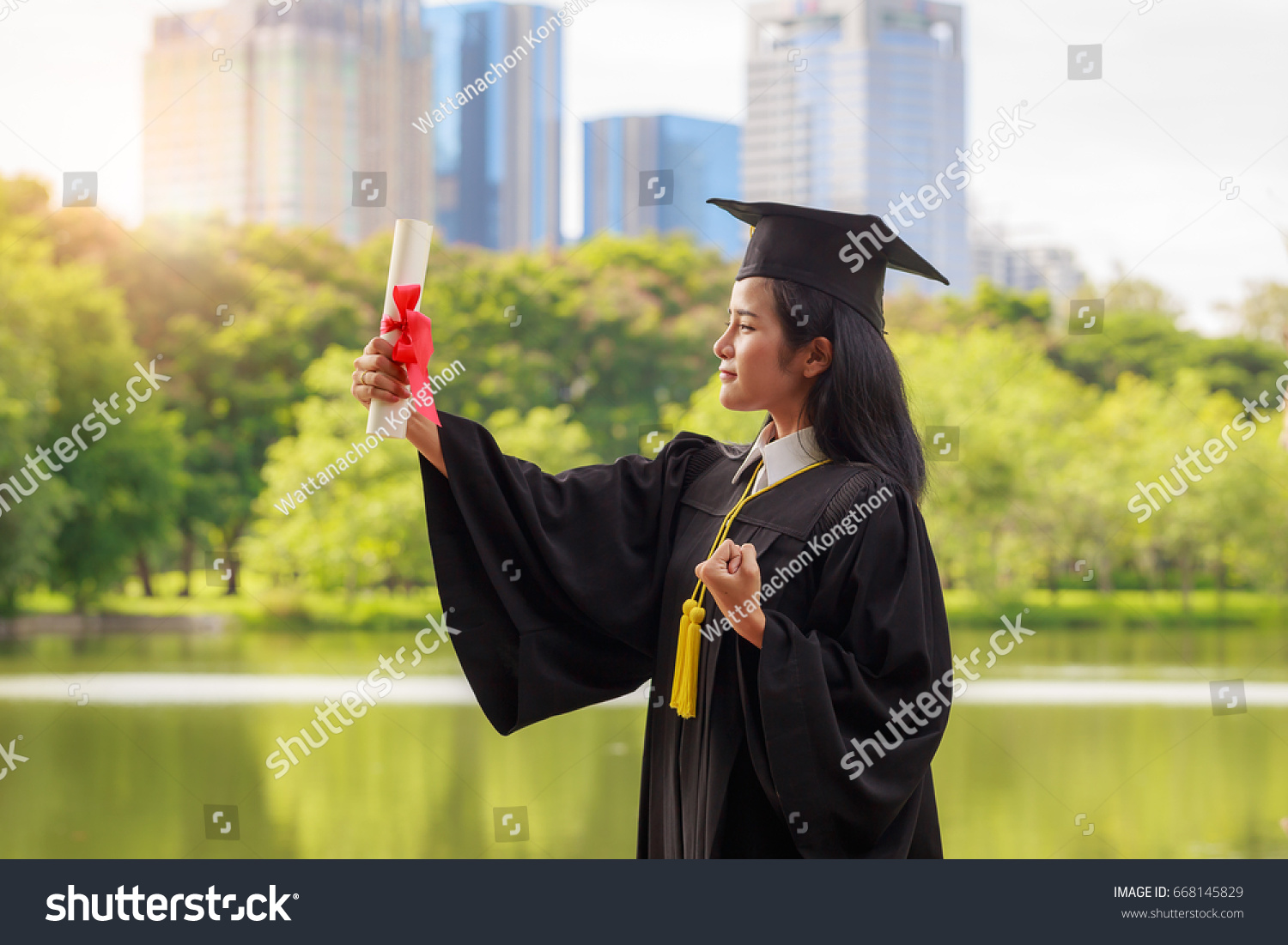 Successful Graduating Student Wearing Cap Gown Stock Photo (Royalty ...