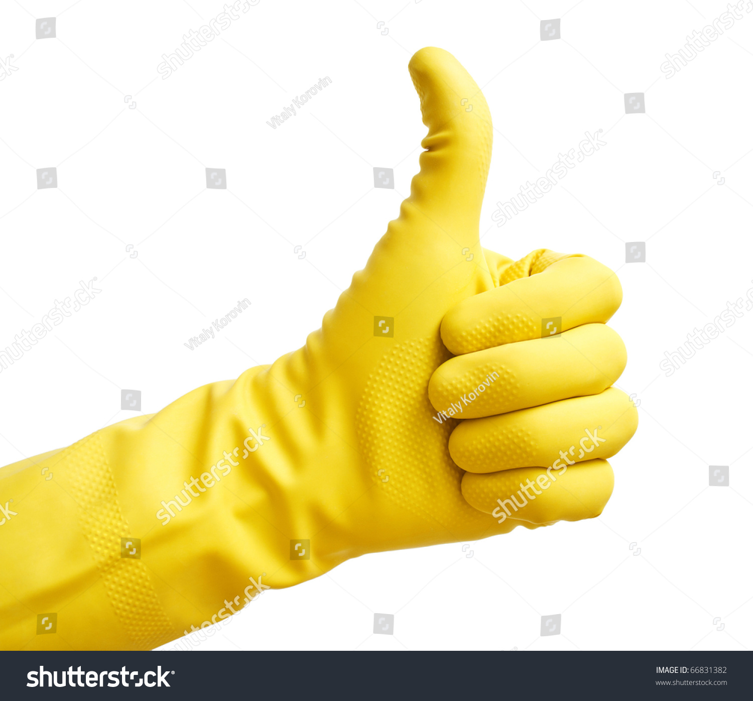 thumbs up with a yellow vinyl glove stock photo 66831382 shutterstock. Black Bedroom Furniture Sets. Home Design Ideas