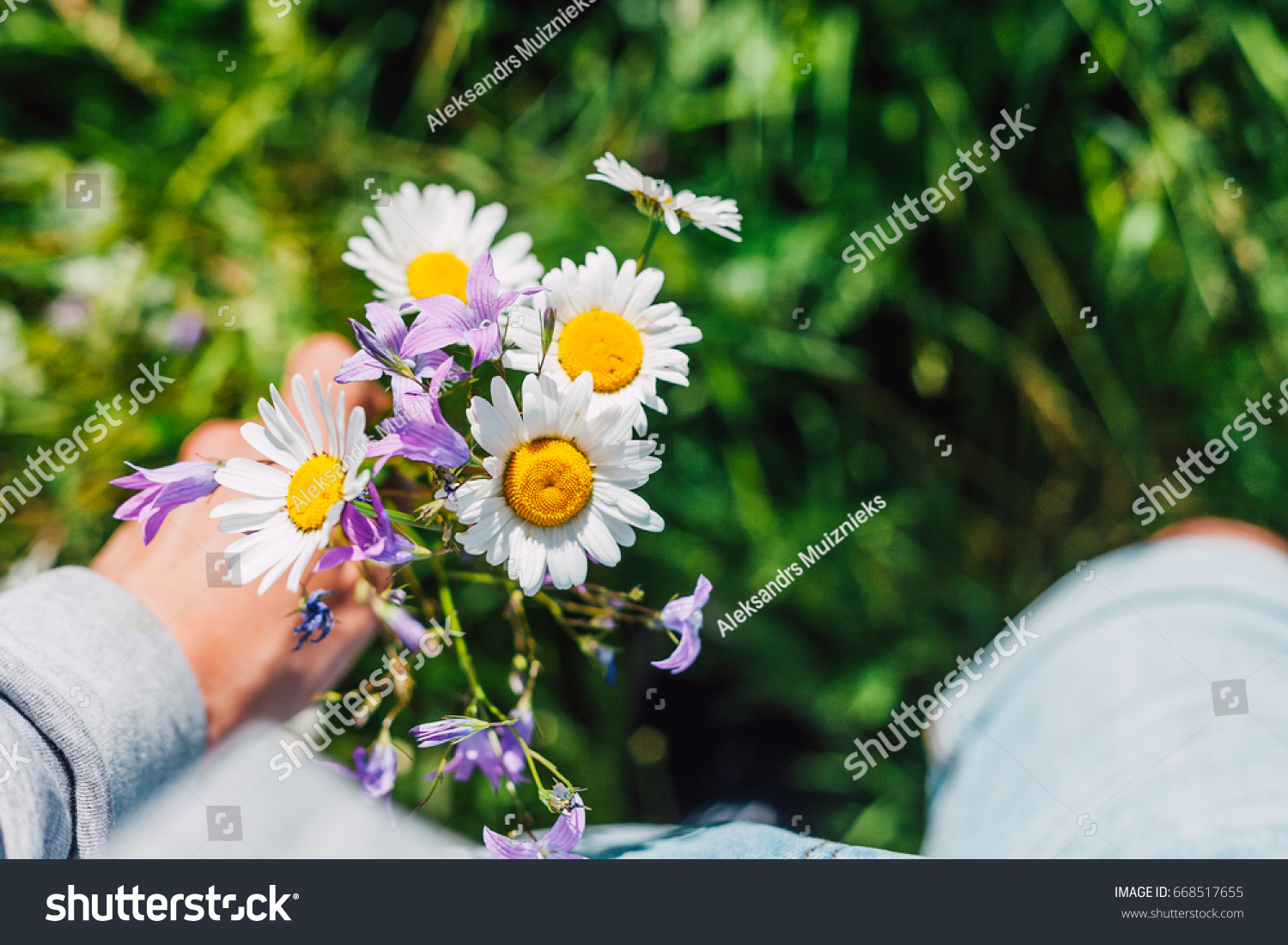 Man holding flowers bouquet summer flowers stock photo image man holding flowers bouquet of summer flowers first person perspective izmirmasajfo