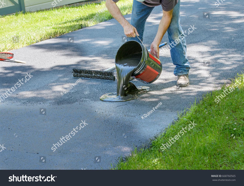 Do yourself home maintenance driveway resealing stock photo do it yourself home maintenance driveway resealing repair homeowner pours blacktop sealant onto driveway solutioingenieria Images