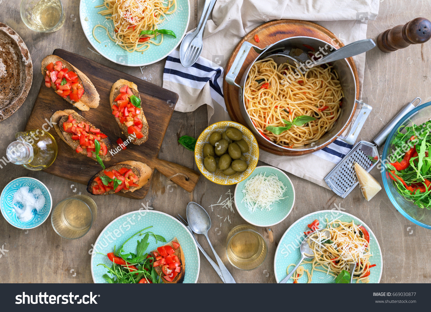 Italian Dinner Table With Pasta, Appetizers And White Wine, Top View