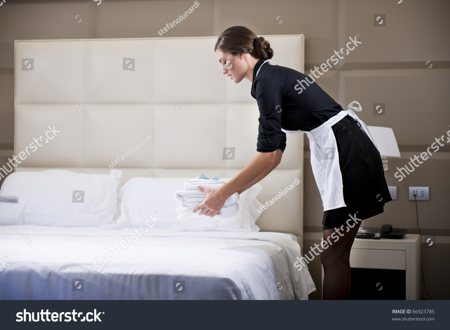 maid making bed hotel room stock photo 66923785 - shutterstock