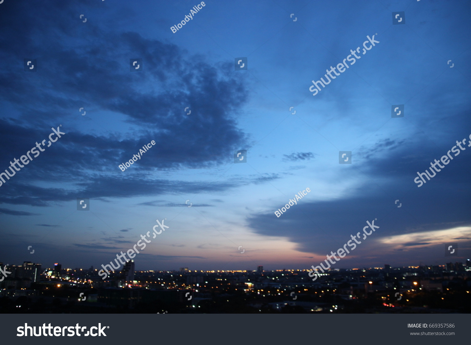 dark blue cloud with white light sky background and city light midnight evening time   #669357586