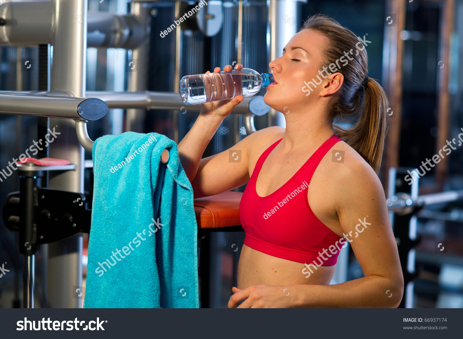 Woman gym drink water after exercise stock photo 66937174 woman in gym drink water after exercise sciox Choice Image