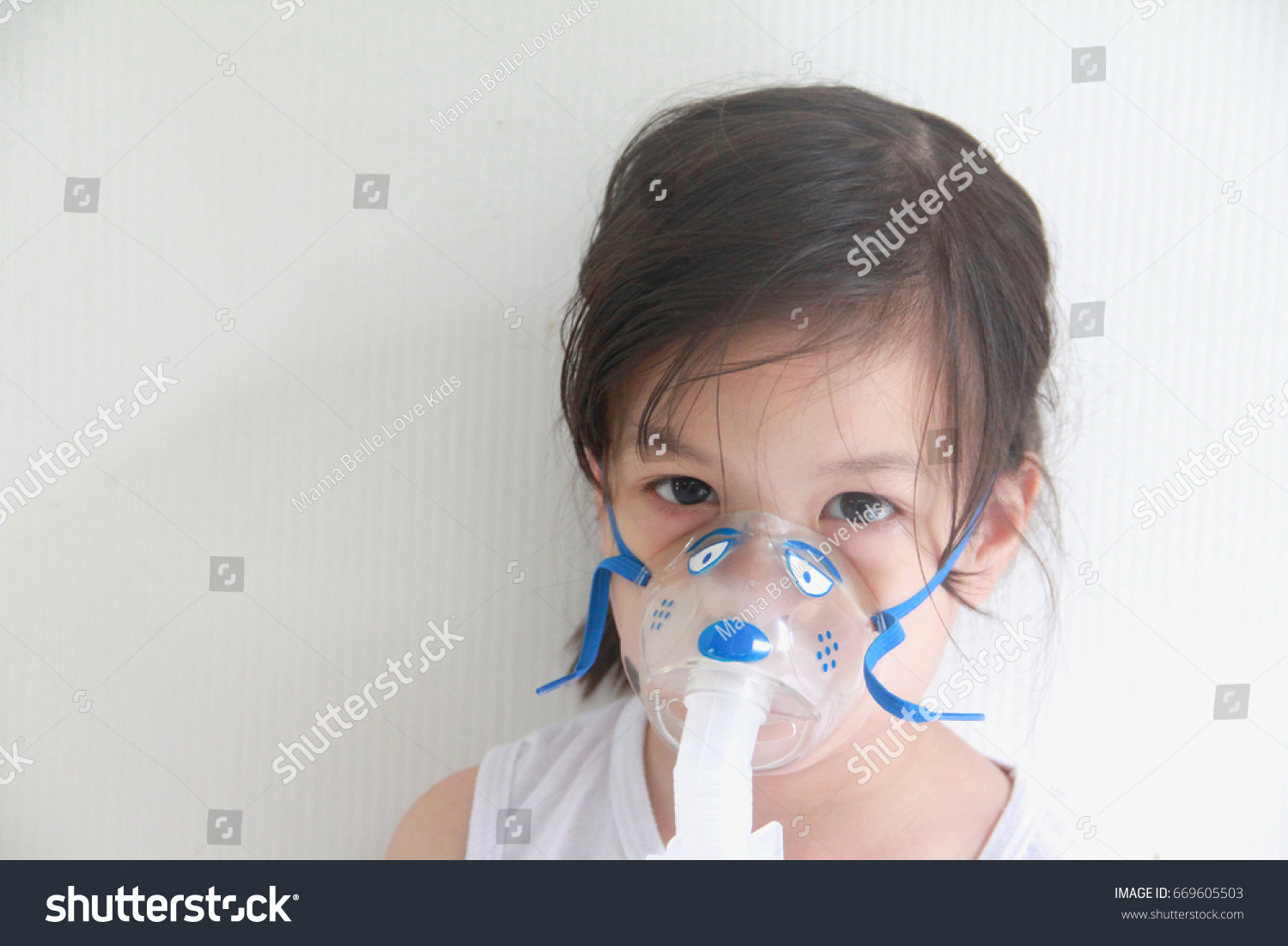 oxygen mask girl Girl has asthma and need nebulizations,Sick girl inhalation therapy by the  mask of inhaler