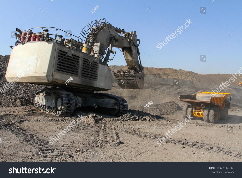 Old excavator in a quarry dump truck mining