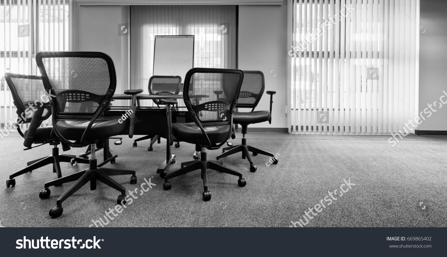 ergonomic office chairs around small conference stock photo edit