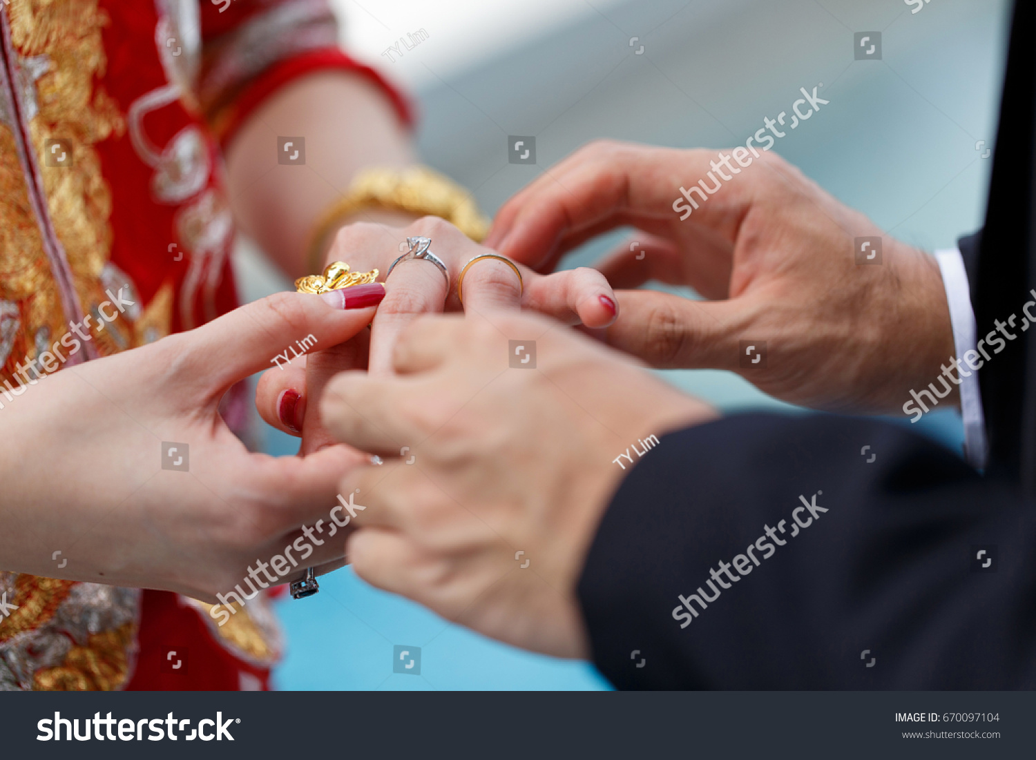 Couple Wearing Wedding Ring During Ceremony Stock Photo Edit Now