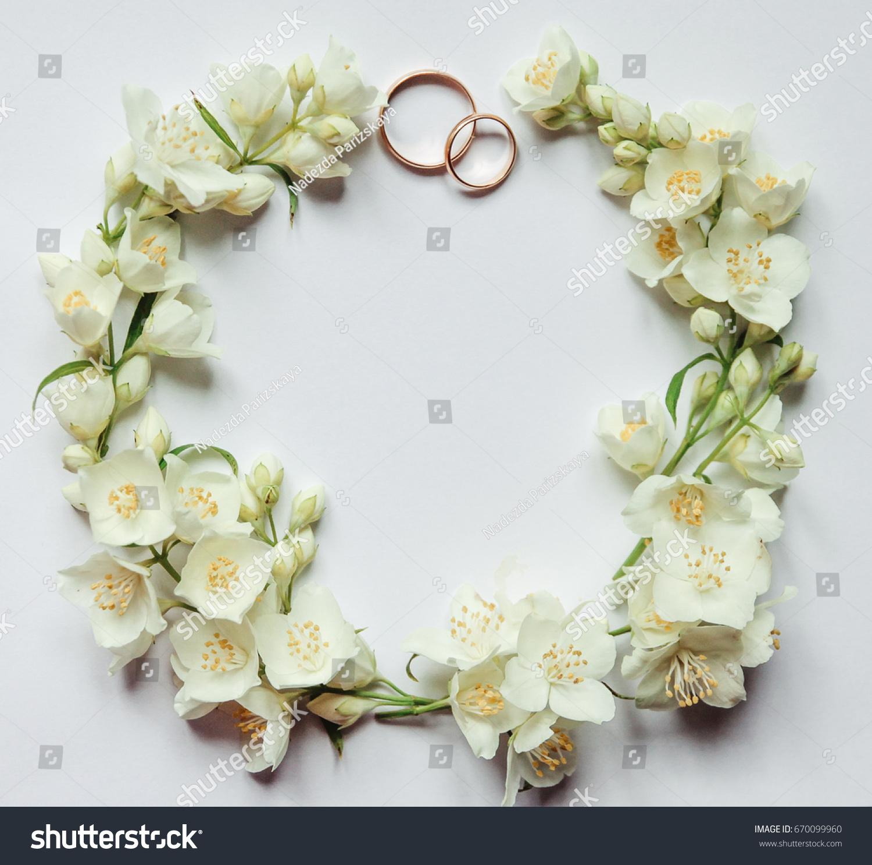 Gold wedding rings on background jasmine stock photo edit now gold wedding rings on a background of jasmine flowers jasmine flowers in the form of izmirmasajfo