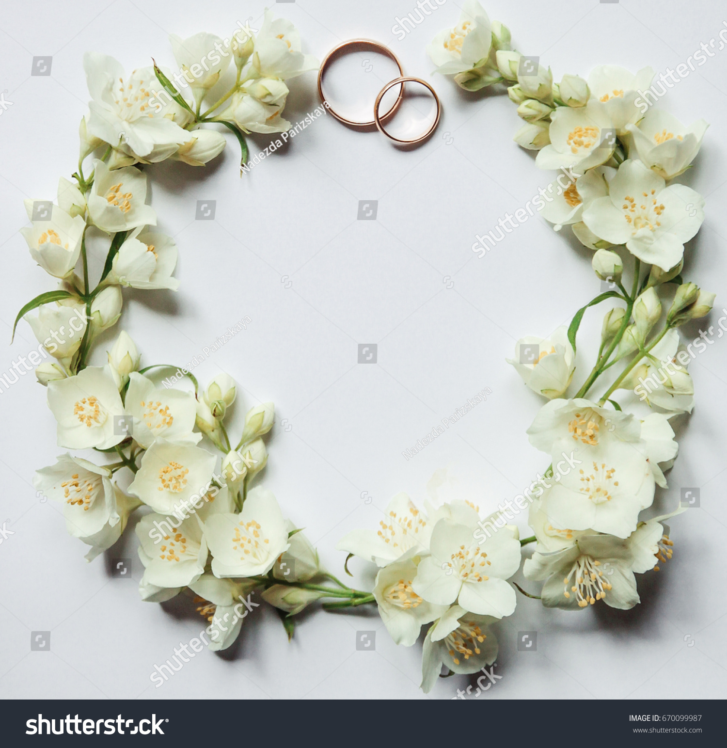 Gold wedding rings on background jasmine stock photo edit now gold wedding rings on a background of jasmine flowers jasmine flowers in the form of izmirmasajfo
