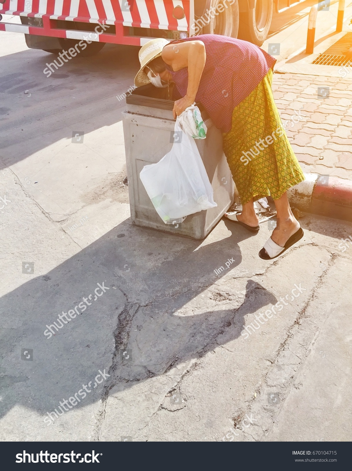 old lady collecting garbage on road stock photo 670104715 - shutterstock