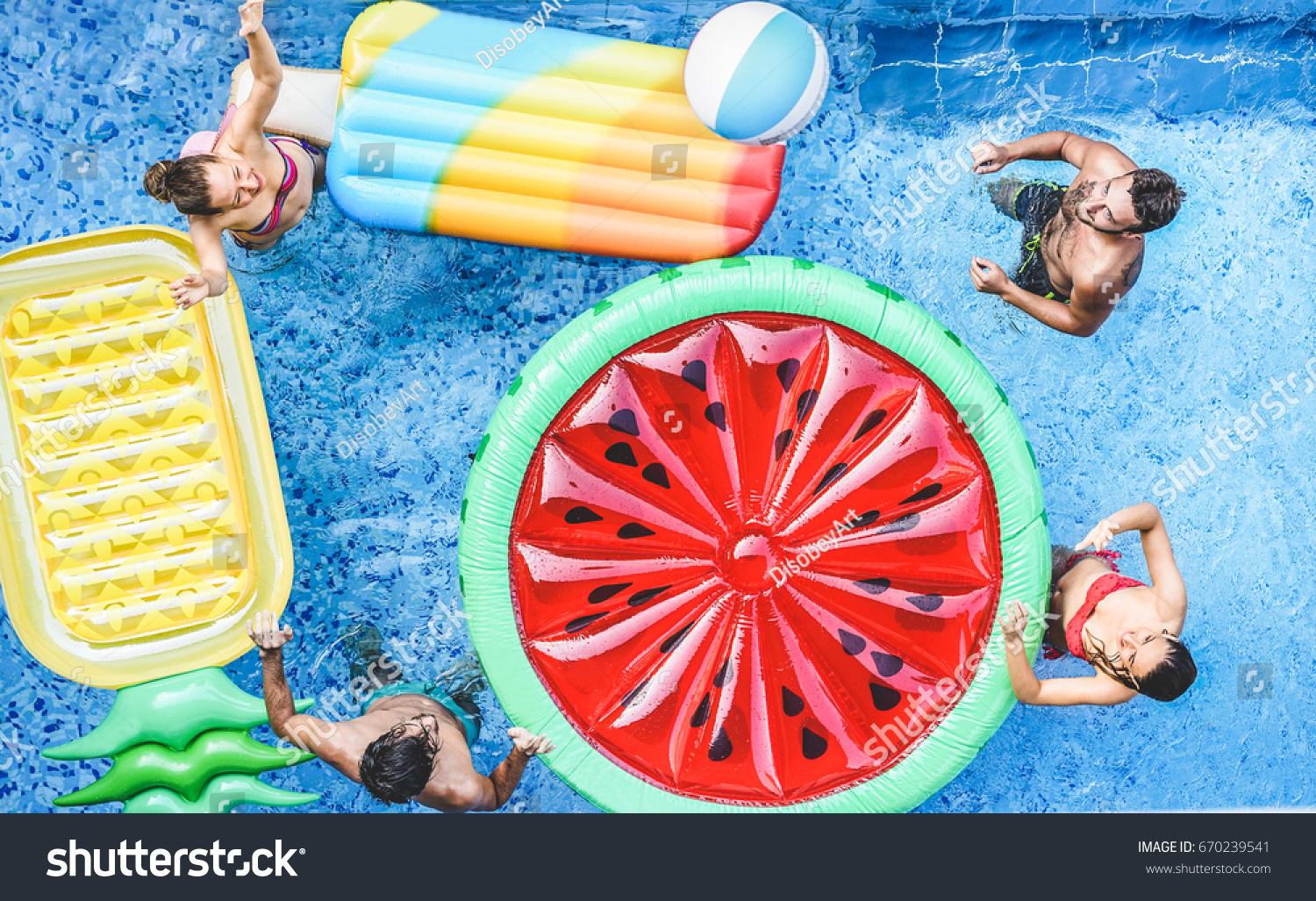 Happy Friends Playing With Ball Inside Swimming Pool