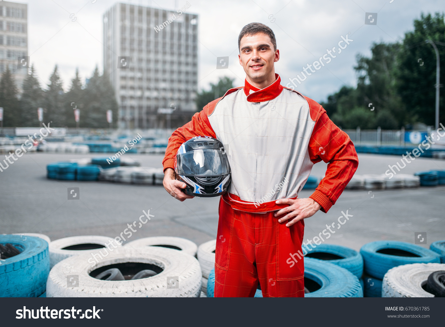 Kart driver with helmet in hands, Go-kart #670361785