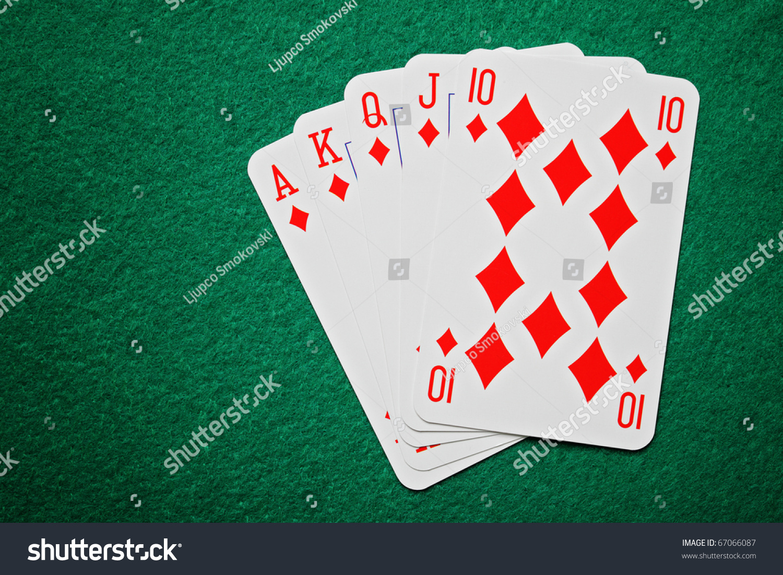 Poker table background - Royal Straight Flush Poker Cards On A Green Felt Table Background
