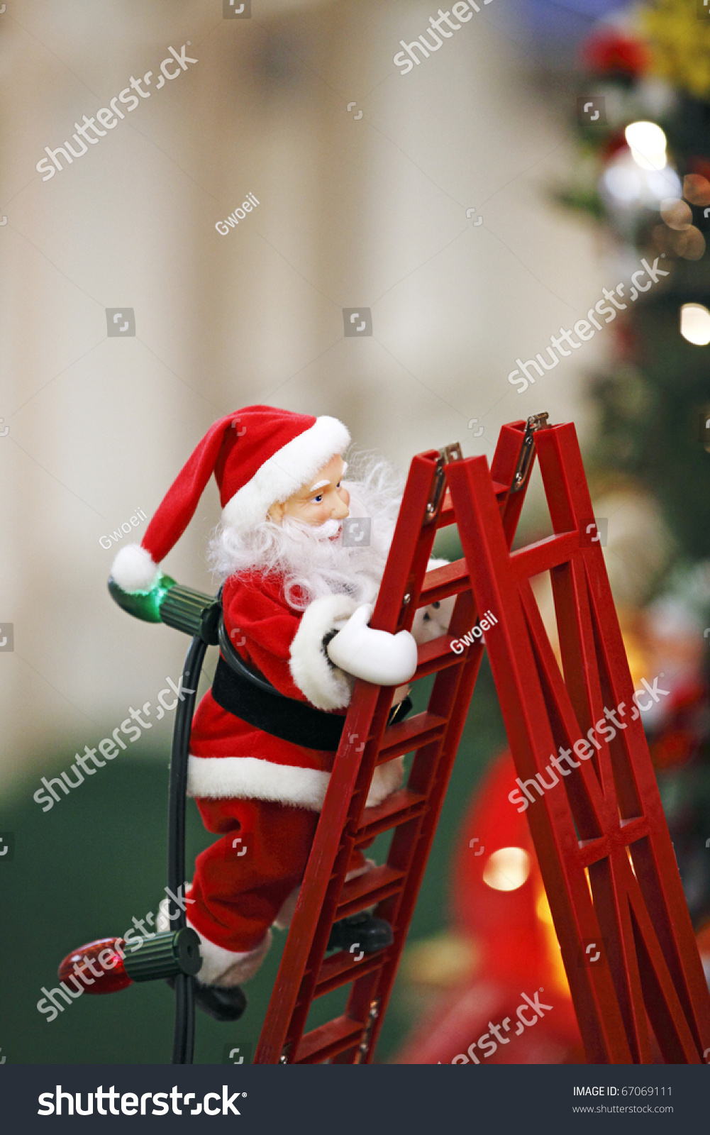 santa claus climbing red ladder carrying stock photo