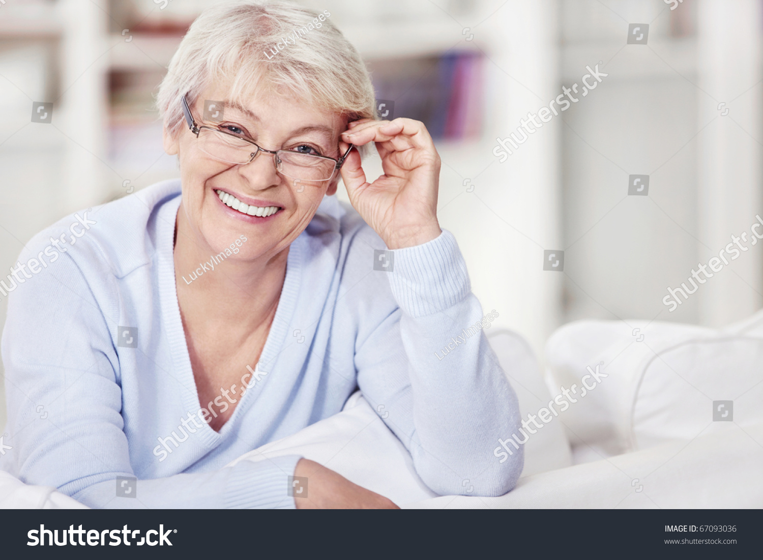 image Attractive granny with glasses fucks her toy boy