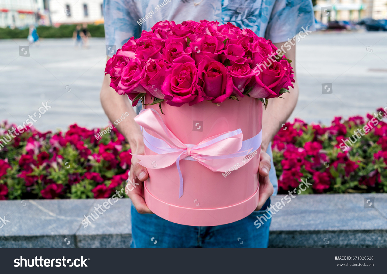 Beautiful flower bouquet pink roses big stock photo edit now beautiful flower bouquet of pink roses in big round pink hat box with ribbon in man izmirmasajfo