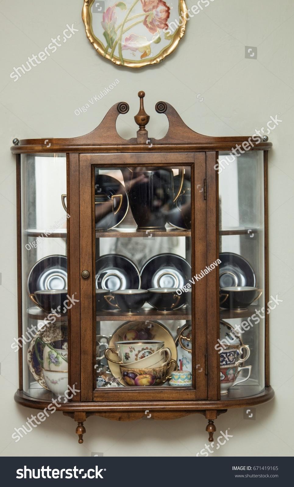 Vintage Curio Cabinet With Porcelain Tea Cup Collection